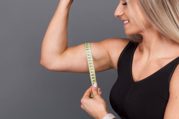 Best Female Biceps Measurement Stock Photos, Pictures
