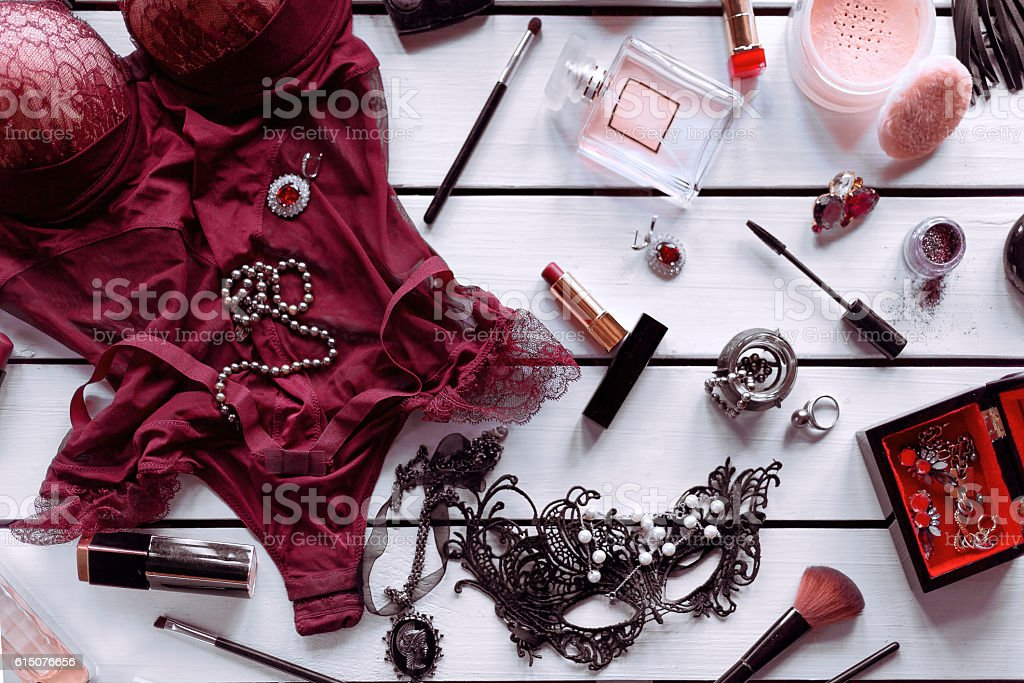 Female bodystocking with cosmetic and accessories on white background - foto de stock