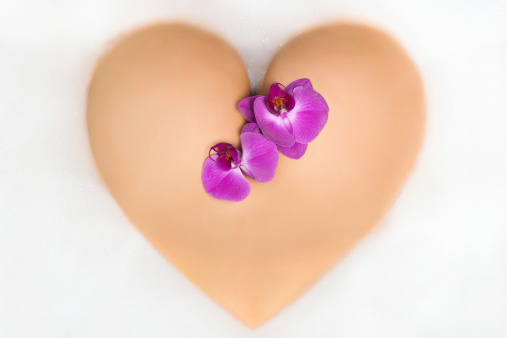 Female Booty In Shape Of A Heart With Orchid Stock Photo - Download Image Now