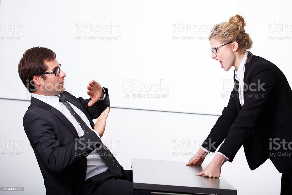 Female boss mad for employee stock photo
