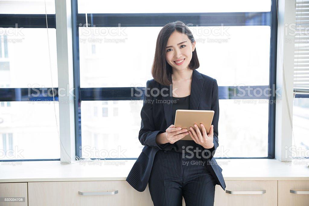 Female boss tablet - Stock image .