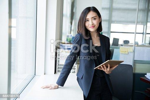 istock female boss tablet 533233170