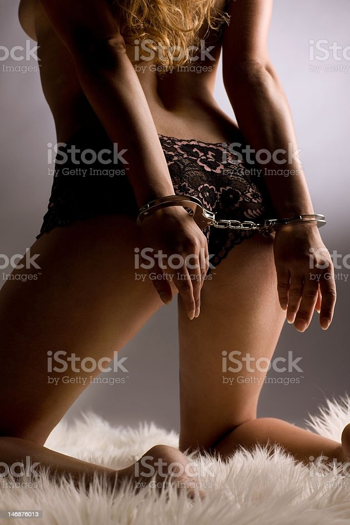 Female bottom from behind with handcuffs stock photo