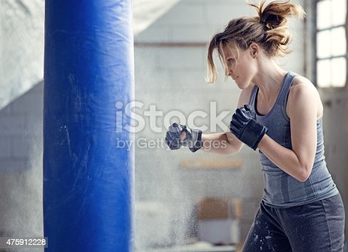 497607484 istock photo Female boxer in an abandoned warehouse 475912228
