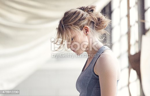 497607484 istock photo Female boxer in an abandoned warehouse 475912230