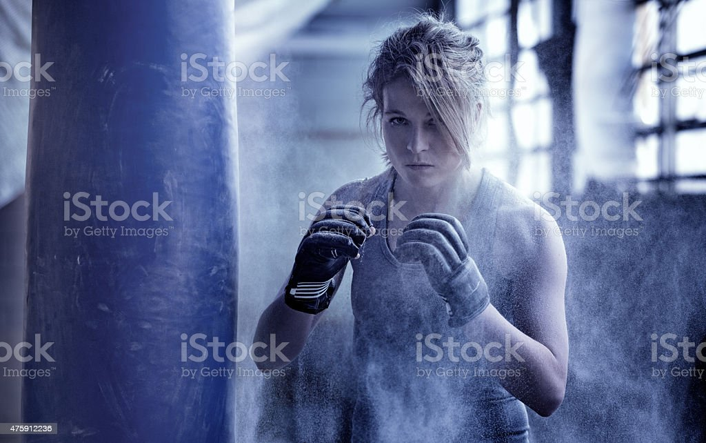 Female boxer in an abandoned warehouse stock photo
