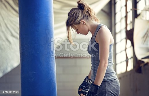 497607484 istock photo Female boxer in an abandoned warehouse 475912238