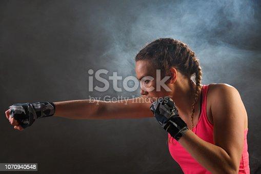 istock Female boxer in fog 1070940548