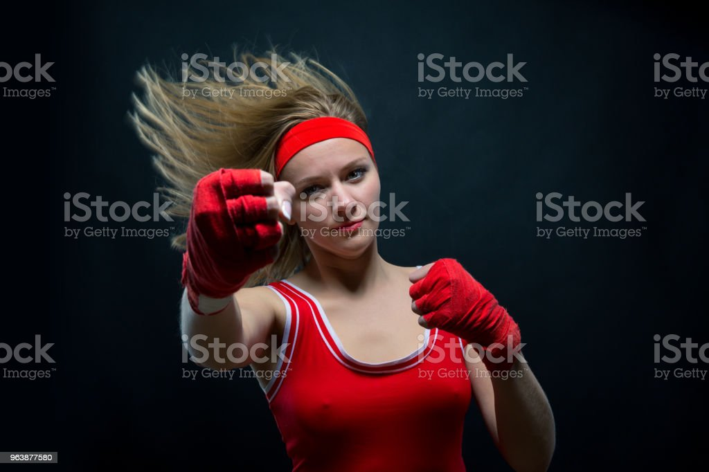 Female boxer in red boxing bandages and sportswear - Royalty-free Adult Stock Photo