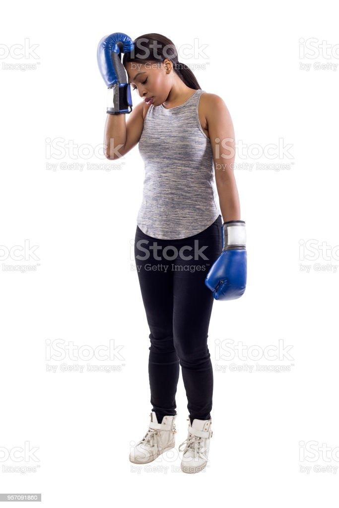 Female Boxer on a White Background Makes a Mistake stock photo