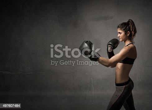 istock female boxer ready fot attack 497607484