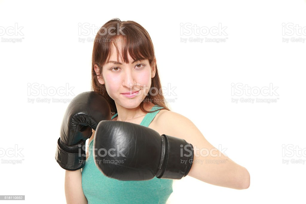 female boxer throws a left hook stock photo