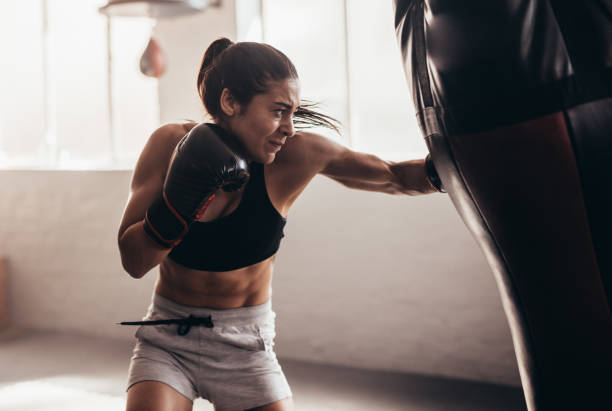 Female boxer training inside a boxing ring stock photo