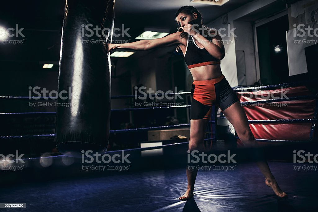 Female Boxer Training With A Punching Bag Stock Photo & More