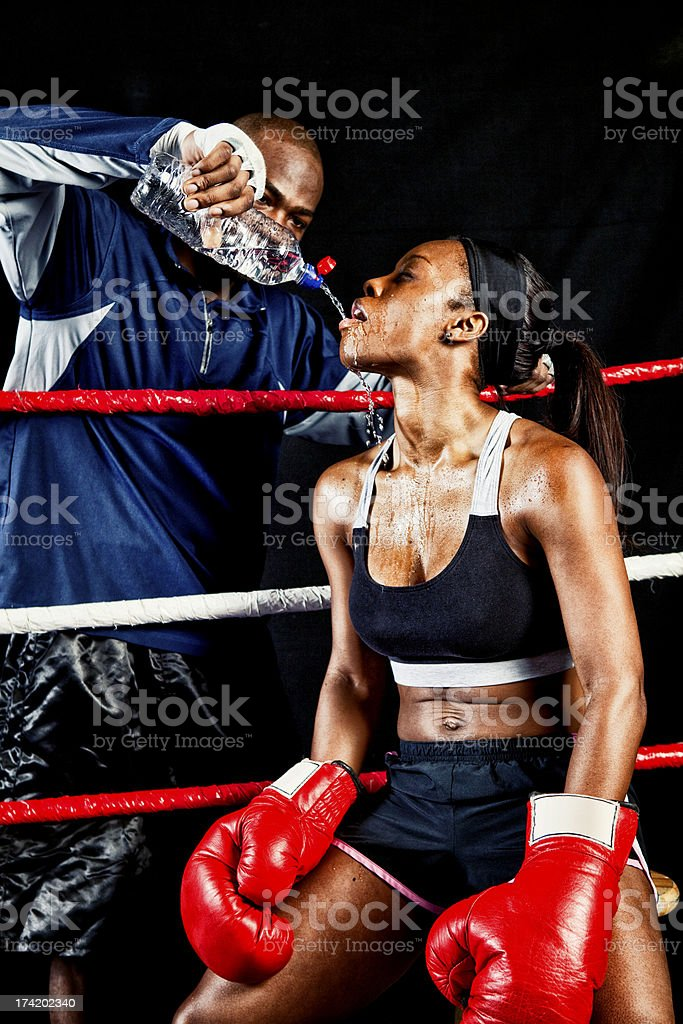 Female Boxer with Coach in the Ring royalty-free stock photo