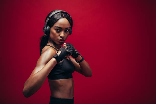 Female boxer with fighting stance stock photo