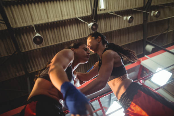 female boxers fighting in boxing ring - punching stock photos and pictures
