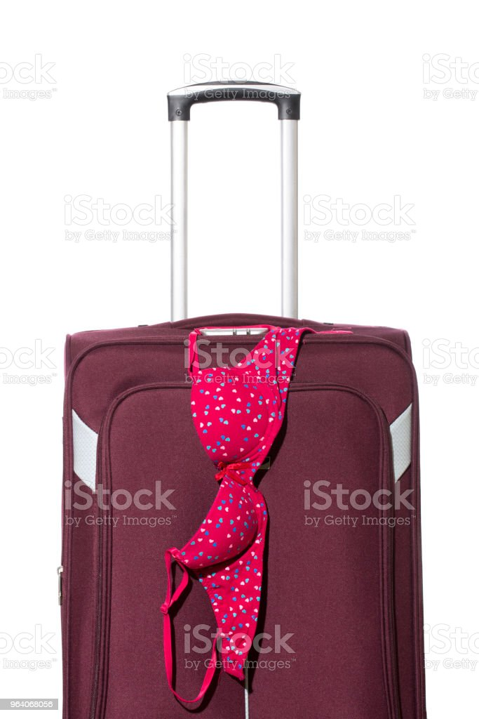 Female bra on travel suitcase with retractable handle - Royalty-free Beauty Stock Photo