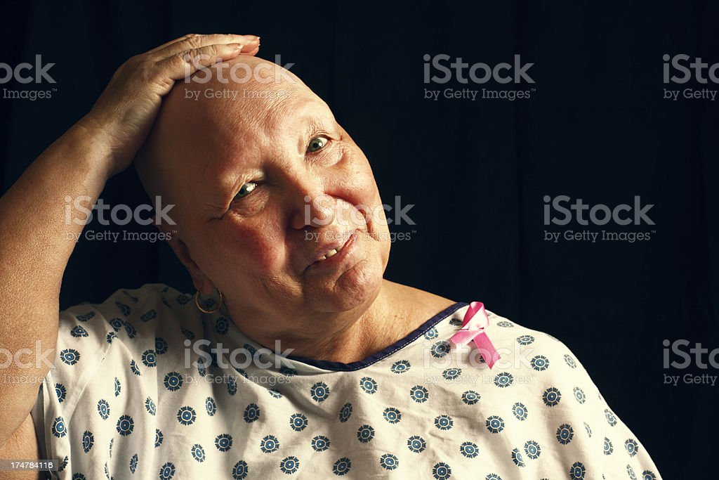 Female breast cancer survivor smiling at the camera stock photo