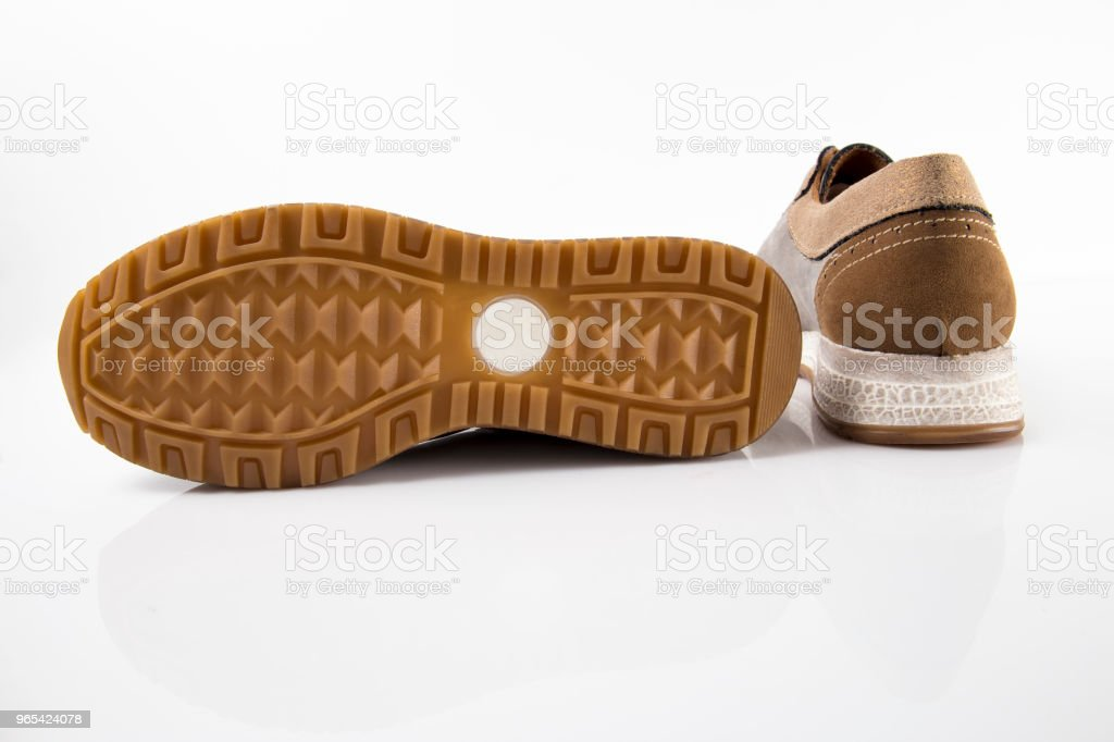 Female brown leather sneaker on white background, isolated product, comfortable footwear. zbiór zdjęć royalty-free