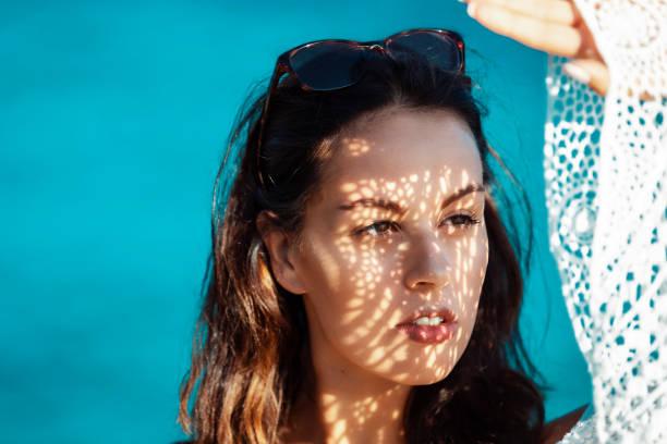 female brunette Mallorca tourist in boho summer dress stock photo