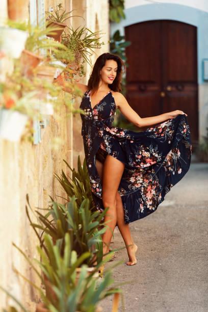 female brunette Mallorca tourist in summer dress stock photo