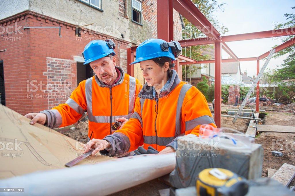 female building surveyor stock photo