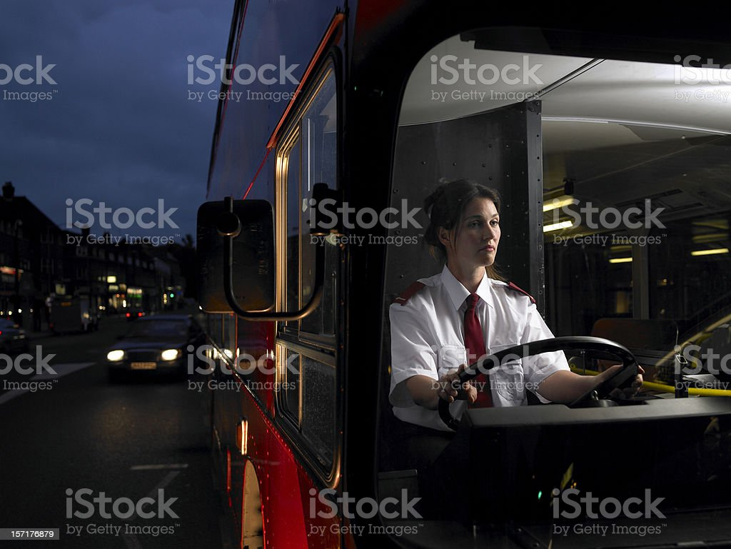 Female bus driver on the road stock photo