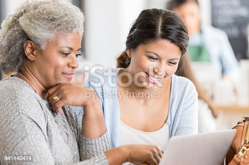 1166905017 istock photo Female business associates meet for coffee 941440414