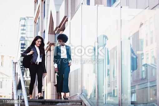 London, Businesswoman, Confidence, Female - Girls having casual conversation while walking towards the underground station
