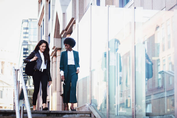 Female Business Colleagues Rushing to Office stock photo