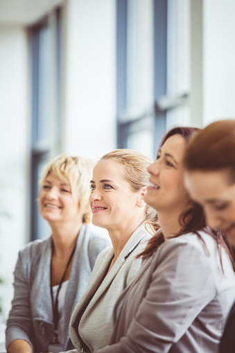 Female Business Executives Attending A Seminar Stock Photo - Download Image Now