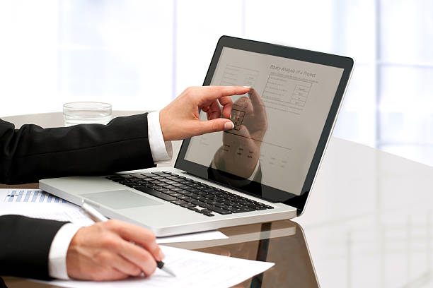 Female business hands working on table. Female business hands working with laptop on table. validation stock pictures, royalty-free photos & images
