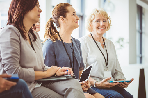 Female Business Professionals At A Seminar Stock Photo - Download Image Now
