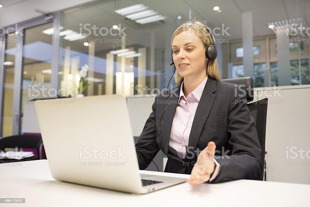 Female  business talk call center operator stock photo
