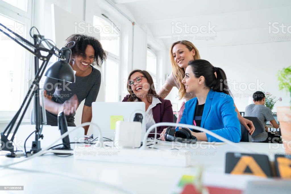 Female business team collaborating on project royalty-free stock photo