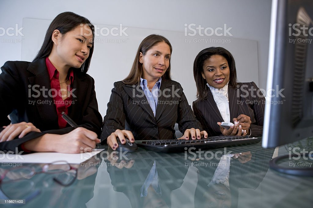 Female Business Team Looking at Computer royalty-free stock photo