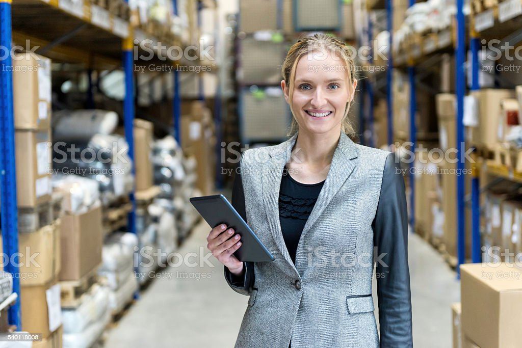 Female businesswoman checking the stocks and using tablet stock photo