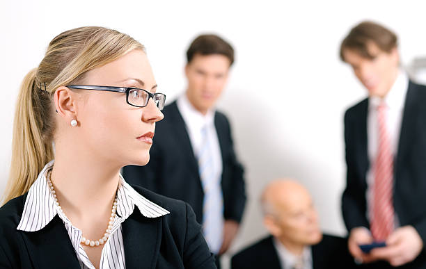 female businesswoman overhears conversation of colleagues - disbarment stock pictures, royalty-free photos & images
