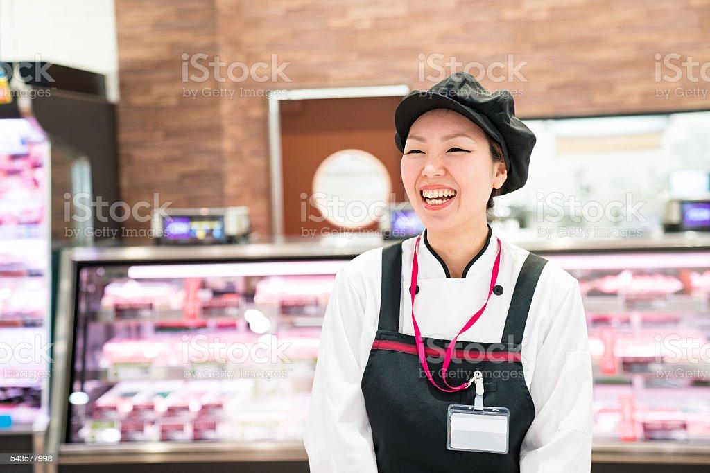 Female butcher in a supermarket stock photo