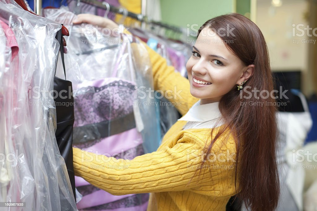 Female buyer chooses evening dress stock photo