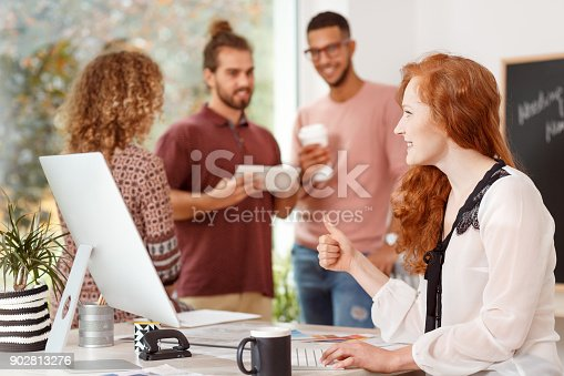 848290020 istock photo Female by the computer 902813276