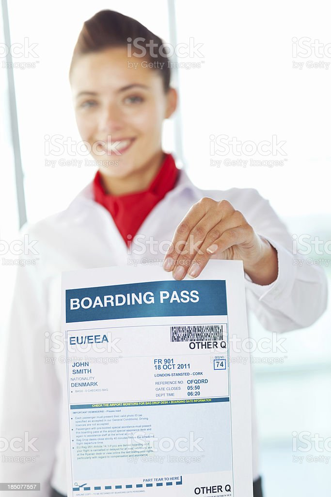 Female Cabin Crew Member Holding Boarding Pass royalty-free stock photo