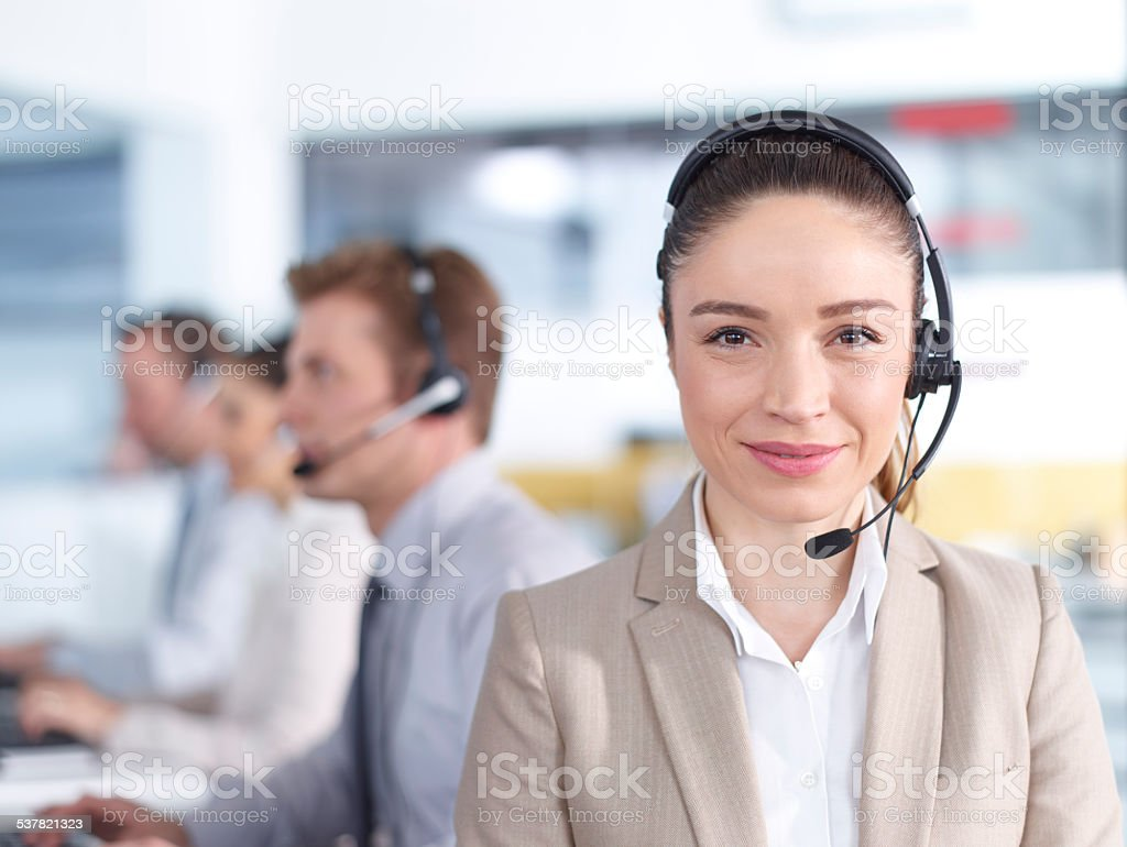 Female call center employee with headset stock photo