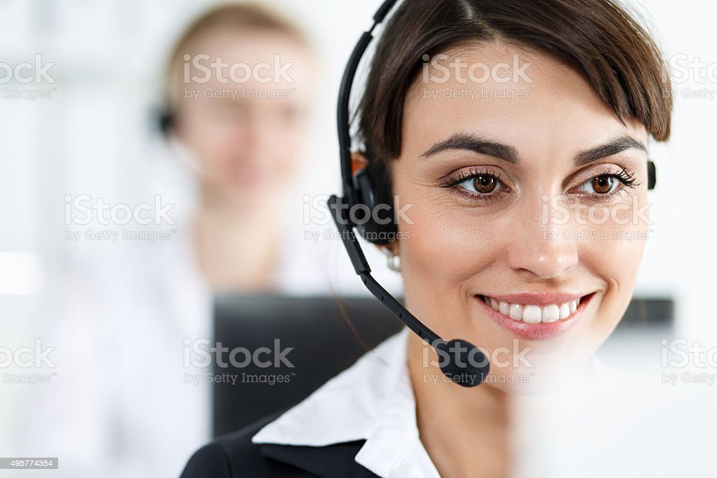 Female call center service operator at work stock photo
