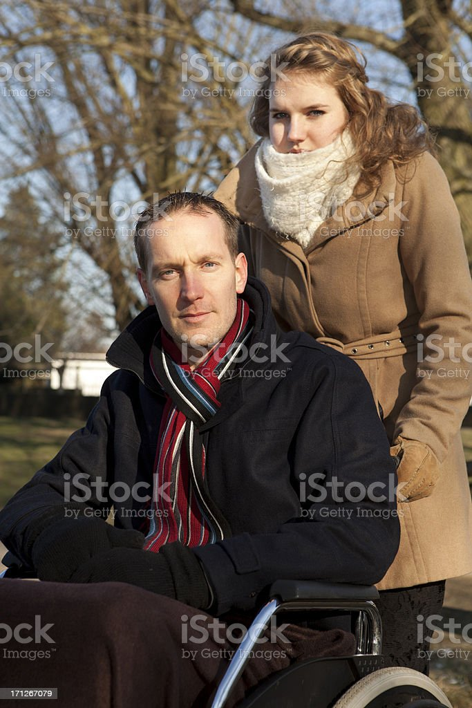 Female Caretaker With Man In Park royalty-free stock photo