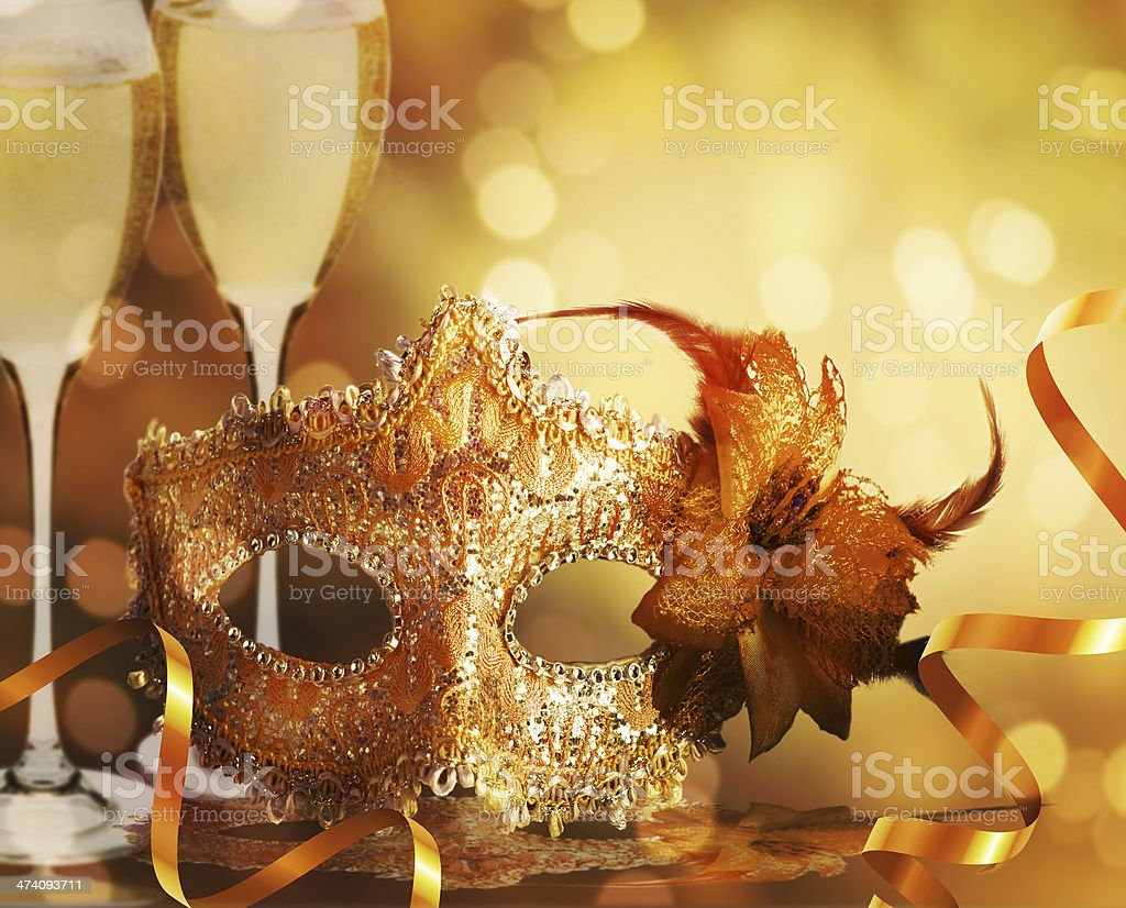 Female carnival mask with golden background stock photo