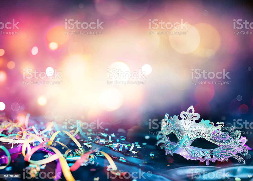 female carnival mask with streamers and Bokeh background stock photo
