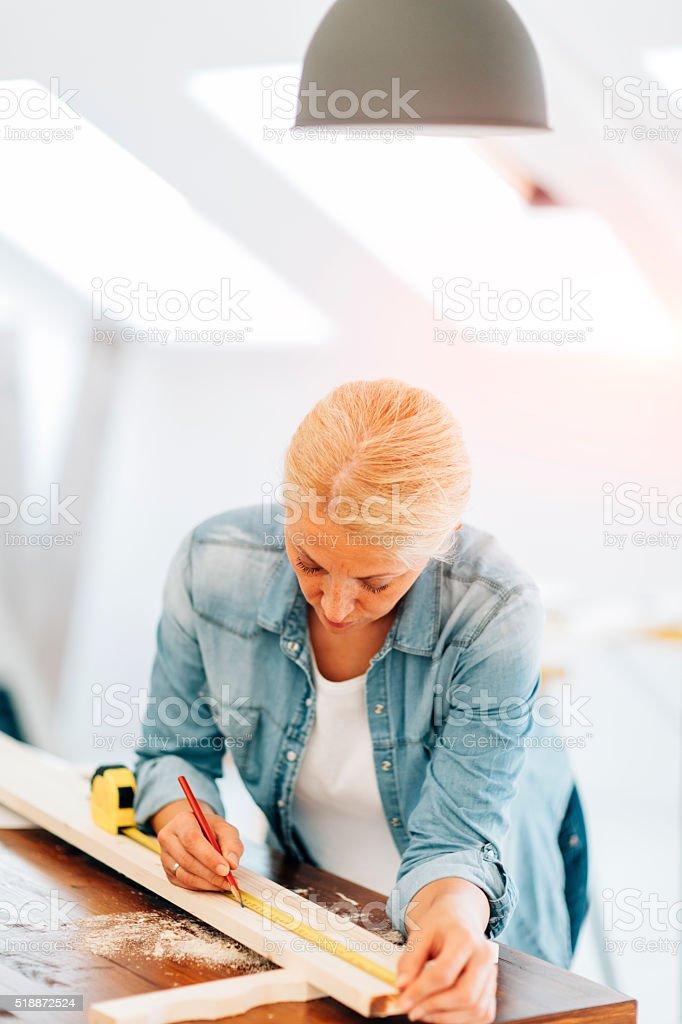Female Carpenter At Work. stock photo