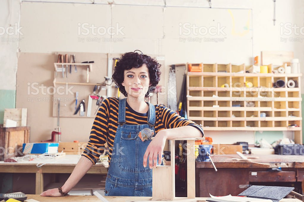 Female carpenter in a construction workshop royalty-free stock photo